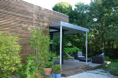 Lassime-Extension-en-ossature-bois-dune-maison-photo-n°2-façade-@a_traits-architecture-1.jpg